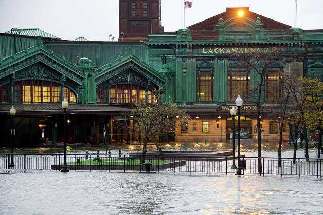 The Hudson River swells and rises over its banks flooding the Lackawanna train station as Hurricane Sandy approaches, in Hoboken, NJ on Monday, Oct. 29, 2012. Hurricane Sandy continued on its path Monday, as the storm forced the shutdown of mass transit, schools and financial markets, sending coastal residents fleeing, and threatening a dangerous mix of high winds and soaking rain. Photo: Charles Sykes, AP / AP2012