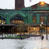 The Hudson River swells and rises over its banks flooding the Lackawanna train station as Hurricane Sandy approaches, in Hoboken, NJ on Monday, Oct. 29, 2012. Hurricane Sandy continued on its path Monday, as the storm forced the shutdown of mass transit, schools and financial markets, sending coastal residents fleeing, and threatening a dangerous mix of high winds and soaking rain.
