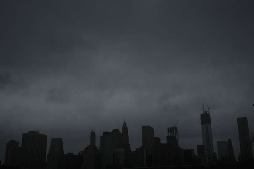 Dark clouds are seen over the skyline of Manhattan as as Hurricane Sandy begins to affect the area o