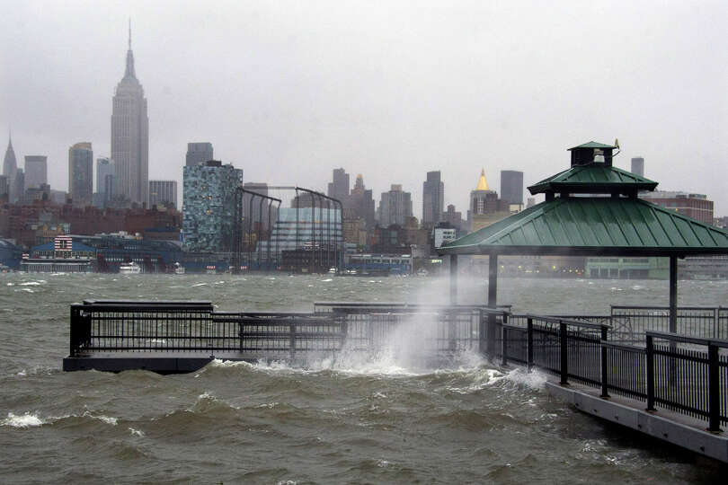 The New York City skyline and Hudson River are seen from Hoboken, NJ as Hurricane Sandy approaches o