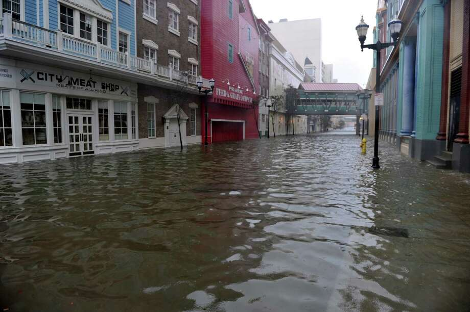 """TOPSHOTS A flooded street between two casinos along the Boardwalk before the arrival of Hurricane Sandy October 29, 2012 in Atlantic City, New Jersey  Much of the eastern United States was in lockdown mode October 29, 2012 awaiting the arrival of a hurricane dubbed """"Frankenstorm"""" that threatened to wreak havoc on the area with storm surges, driving rain and devastating winds.  AFP PHOTO/Stan HONDASTAN HONDA/AFP/Getty Images Photo: STAN HONDA, AFP/Getty Images / AFP"""