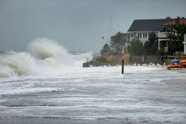Waves pound the shore along the Penfield Beach area in Fairfield, Conn. on Monday, Oct. 29, 2012. High winds from Hurricane Sandy moved into southern Connecticut on Monday morning. Conditions are expected to get worse at the next high tide around midnight tonight. Photo: Cathy Zuraw