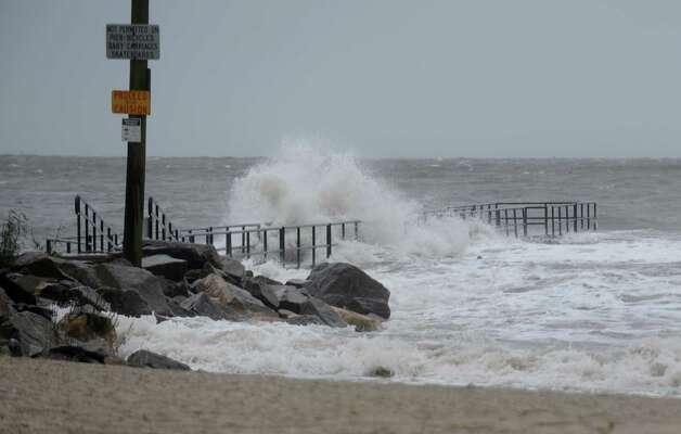 Waves pound the South Benson Marina beach area in Fairfield, Conn. on Monday, Oct. 29, 2012. High winds from Hurricane Sandy moved into southern Connecticut on Monday morning. Conditions are expected to get worst at the next high tide around midnight tonight. Photo: Cathy Zuraw