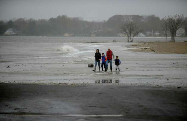 Curious people stop at Sasco Beach get a look at the rough surf in Fairfield, Conn. on Monday, Oct. 29, 2012. High winds from Hurricane Sandy moved into southern Connecticut on Monday morning. Conditions are expected to get worse at the next high tide around midnight tonight. Photo: Cathy Zuraw