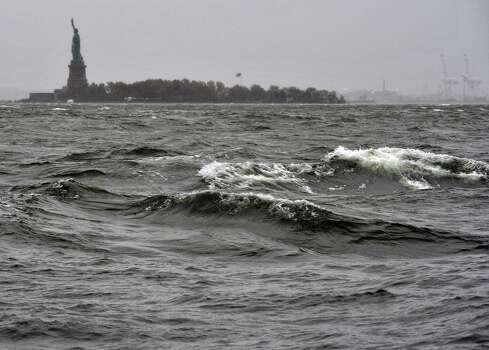 "High surf on the Hudson River near the Statue of Liberty  October 29, 2012 as New Yorkers prepare for Hurricane Sandy expected to hit the city later tonight Much of the eastern United States was in lockdown mode October 29, 2012 awaiting the arrival of a hurricane dubbed ""Frankenstorm"" that threatened to wreak havoc on the area with storm surges, driving rain and devastating winds. 