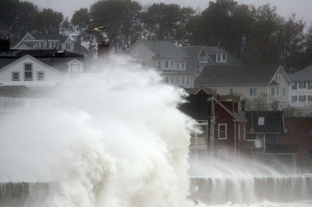 Waves crash over Winthrop Shore Drive as Hurricane Sandy comes up the coast on October 29, 2012 in Winthrop, Massachusetts. Hurricane Sandy, which threatens 50 million people in the eastern third of the U.S., is expected to bring days of rain, high winds and possibly heavy snow to a wide area on the U.S. East Coast. Photo: Darren McCollester, Getty Images / 2012 Getty Images