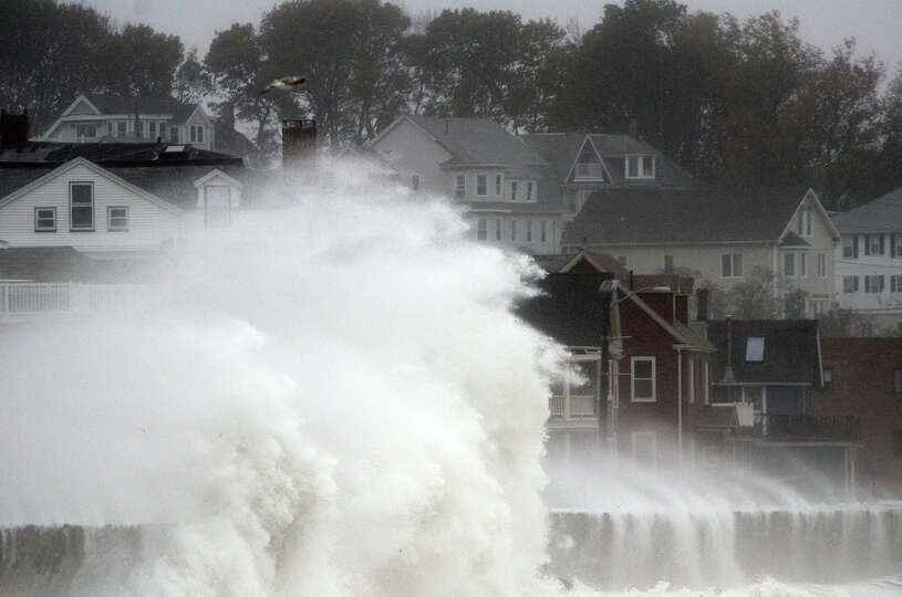 Waves crash over Winthrop Shore Drive as Hurricane Sandy comes up the coast on October 29, 2012 in W