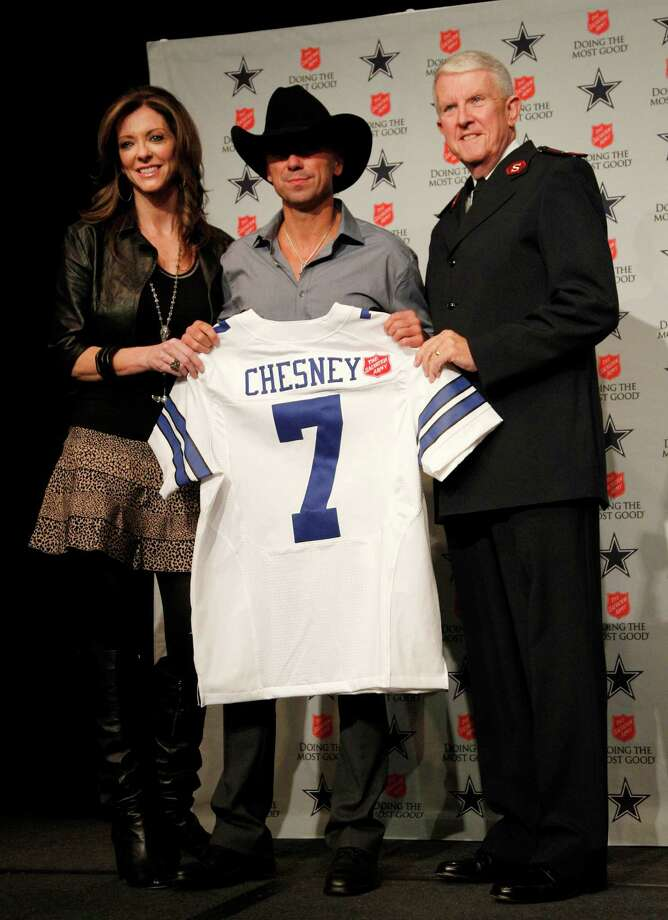 "Kenny Chesney (center) has a shot at  Entertainer of the Year,  Musical Event of the Year for  ""Feel Like A Rockstar"" and Music Video of the Year for ""Come Over."" Photo: Tony Gutierrez, Associated Press / AP"