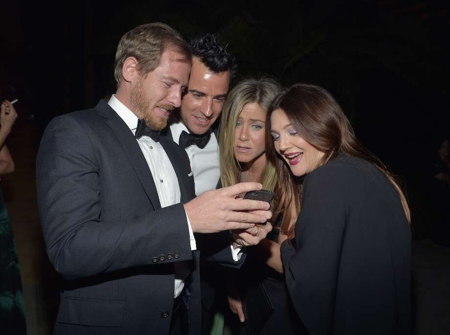 (L-R) Art consultant Will Kopelman and actors Justin Theroux, Jennifer Aniston and Drew Barrymore attend LACMA 2012 Art + Film Gala Honoring Ed Ruscha and Stanley Kubrick presented by Gucci at LACMA on October 27, 2012 in Los Angeles, California. Photo: Charley Gallay, Getty Images For LACMA / 2012 Getty Images