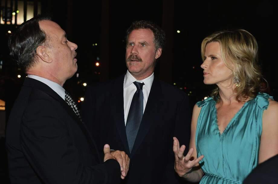 (L-R) Actors Tom Hanks, Will Ferrell and Viveca Paulin arrive at LACMA 2012 Art + Film Gala Honoring Ed Ruscha and Stanley Kubrick presented by Gucci at LACMA on October 27, 2012 in Los Angeles, California. Photo: Frazer Harrison, Getty Images For LACMA / 2012 Getty Images