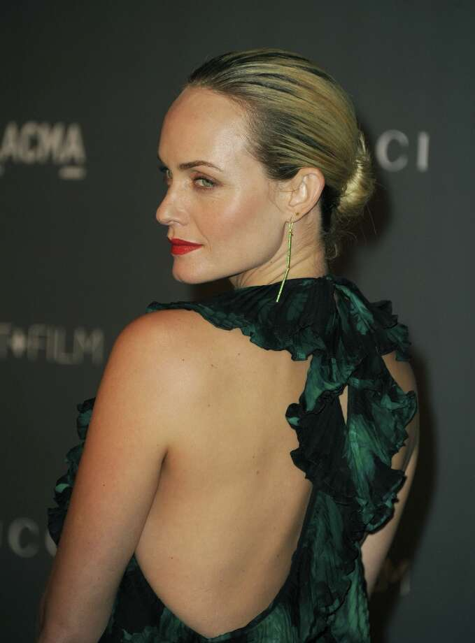 Actress Amber Valletta arrives at LACMA 2012 Art + Film Gala at LACMA on October 27, 2012 in Los Angeles, California. Photo: Kevin Winter, Getty Images / 2012 Getty Images