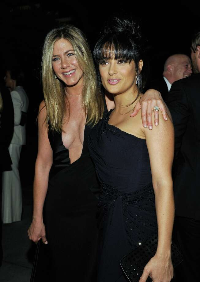 Actresses Jennifer Aniston (L) and Salma Hayek attend LACMA 2012 Art + Film Gala Honoring Ed Ruscha and Stanley Kubrick presented by Gucci at LACMA on October 27, 2012 in Los Angeles, California. Photo: John Sciulli, Getty Images For LACMA / 2012 Getty Images