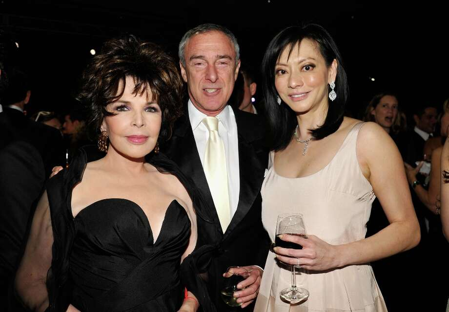 (L-R) Songwriter Carole Bayer Sager, Global Eagle Acquisition Corporation Chairman & CEO Harry Sloan, and Florence Sloan attend LACMA 2012 Art + Film Gala Honoring Ed Ruscha and Stanley Kubrick presented by Gucci at LACMA on October 27, 2012 in Los Angeles, California. Photo: John Sciulli, Getty Images For LACMA / 2012 Getty Images