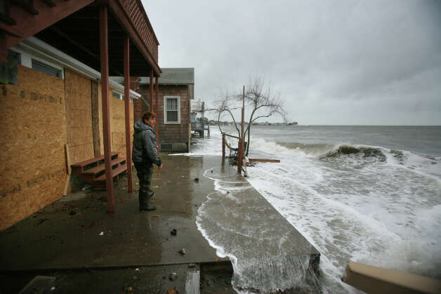 Jay Johnson of Milford surveys the storm surge from Hurricane Sandy at his waterfront home on Melba Street in Milford on Monday, October 29, 2012. Photo: Brian A. Pounds
