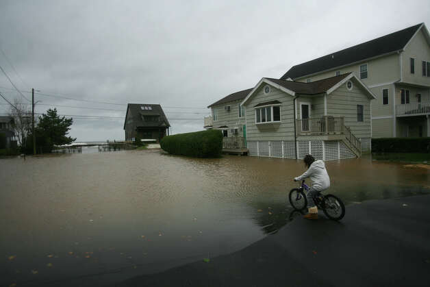Flooding from Hurricane Sandy on Point Beach Drive in Milford on Monday, October 29, 2012. Photo: Brian A. Pounds