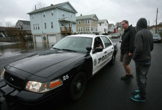 Police patrol the Point Beach neighborhood during the arrival of Hurricane Sandy in Milford on Monday, October 29, 2012. Photo: Brian A. Pounds