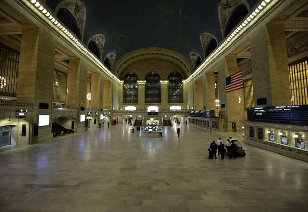 MTA Police watch over as the last people are cleared out of Grand Central Station in New York  October 28, 2012  as the  MTA has been began an orderly shutdown of commuter rail and subway service in preparation for Hurricane Sandy . AFP PHOTO / TIMOTHY A. CLARYTIMOTHY A. CLARY/AFP/Getty Images Photo: TIMOTHY A. CLARY, AFP/Getty Images / AFP