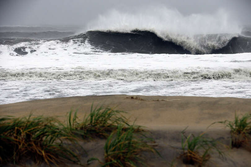 A huge wave crashes on the beach as Hurricane Sandy bears down on the East Coast, Monday, Oct. 29, 2