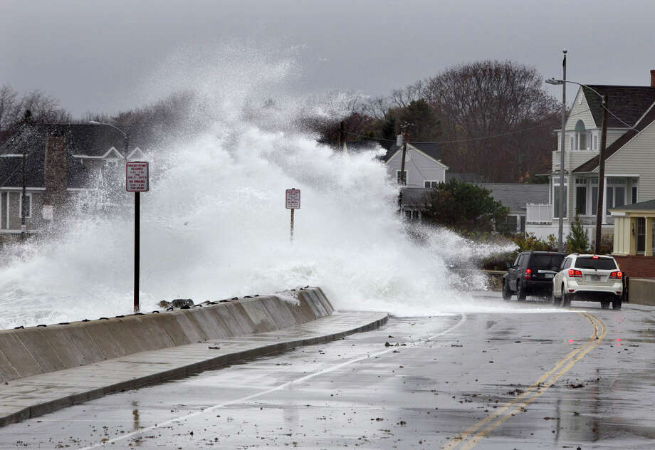 Heavy surf crashes over a seawall on the Atlantic Ocean during the early stages of Hurricane Sandy, Monday, Oct. 29, 2012, in Kennebunk, Maine. Hurricane Sandy wheeled toward land as forecasters feared Monday, raking cities along the Northeast corridor with rain and wind gusts, flooding shore towns, washing away a section of the Atlantic City Boardwalk, and threatening to cripple Wall Street and New York's subway system with a huge surge of corrosive seawater. Photo: Robert F. Bukaty, AP / AP2012