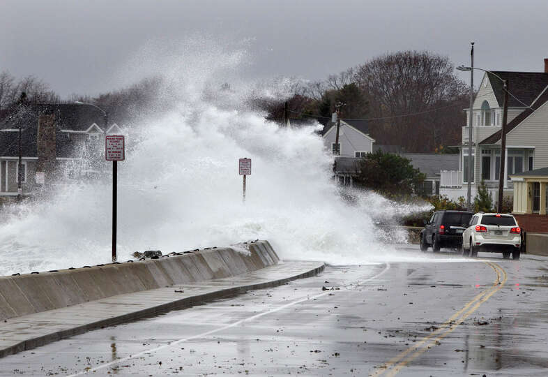 Heavy surf crashes over a seawall on the Atlantic Ocean during the early stages of Hurricane Sandy,