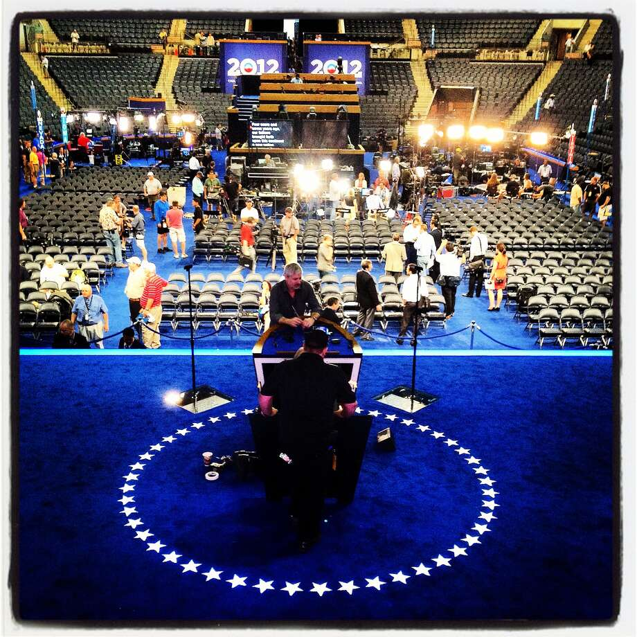 Workers make preparations on the stage before the start of the Democratic National Convention (DNC) at Time Warner Cable Arena September 3, 2012 in Charlotte, North Carolina. The Democratic National Convention is scheduled to start on Tuesday and run through September 6th. Photo: Justin Sullivan, Getty Images / 2012 Getty Images