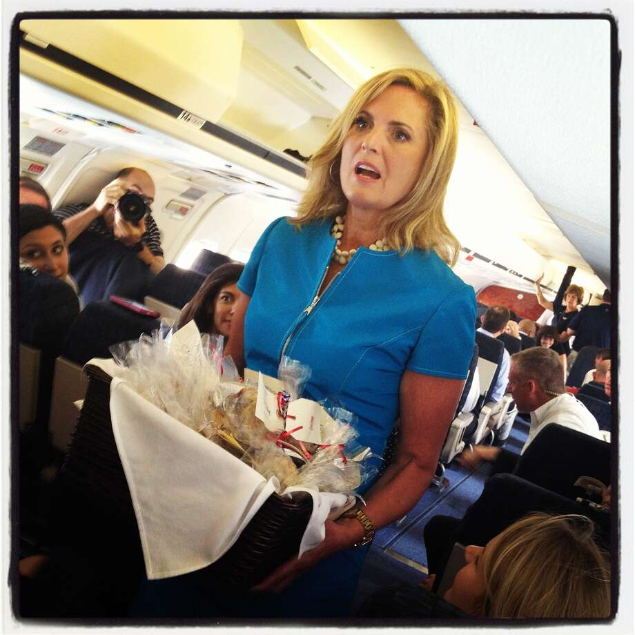 Ann Romney, wife of Republican presidential candidate, former Massachusetts Gov. Mitt Romney, passes out homemade Welsh Cakes to members of the traveling press aboard the campaign plane on September 1, 2012 in Cincinnati, Ohio. Mitt Romney will hold campaign events in Ohio and Florida. Photo: Justin Sullivan, Getty Images / 2012 Getty Images