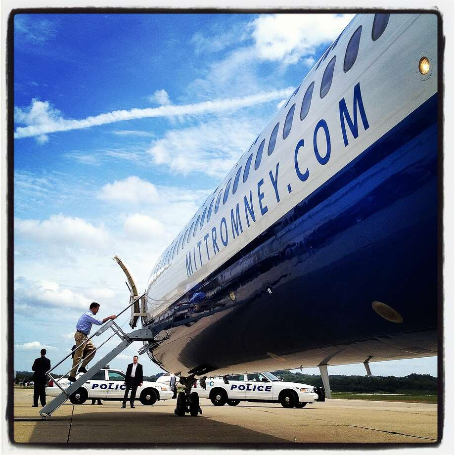 Republican presidential candidate, former Massachusetts Gov. Mitt Romney (C), boards the campaign plane on September 1, 2012 in Cincinnati, Ohio. Mitt Romney will hold campaign events in Ohio and Florida. Photo: Justin Sullivan, Getty Images / 2012 Getty Images