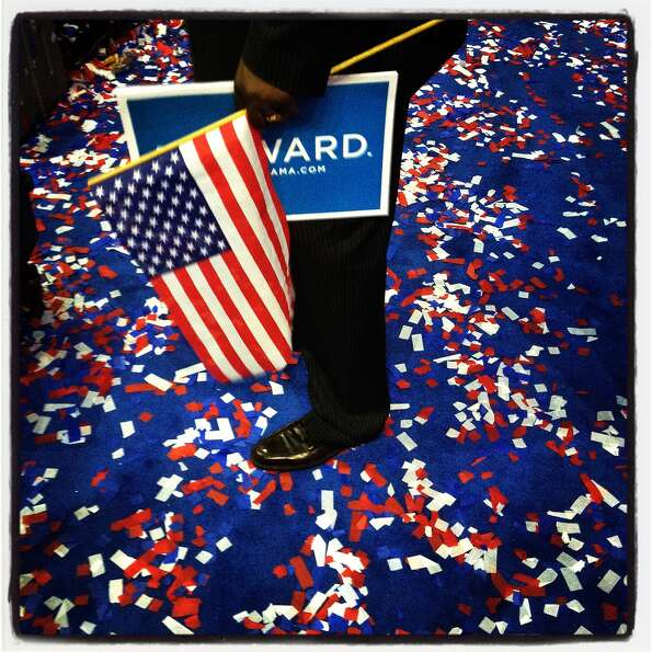 A man stands amid confetti at the end of the third day of the Democratic National Convention at Time