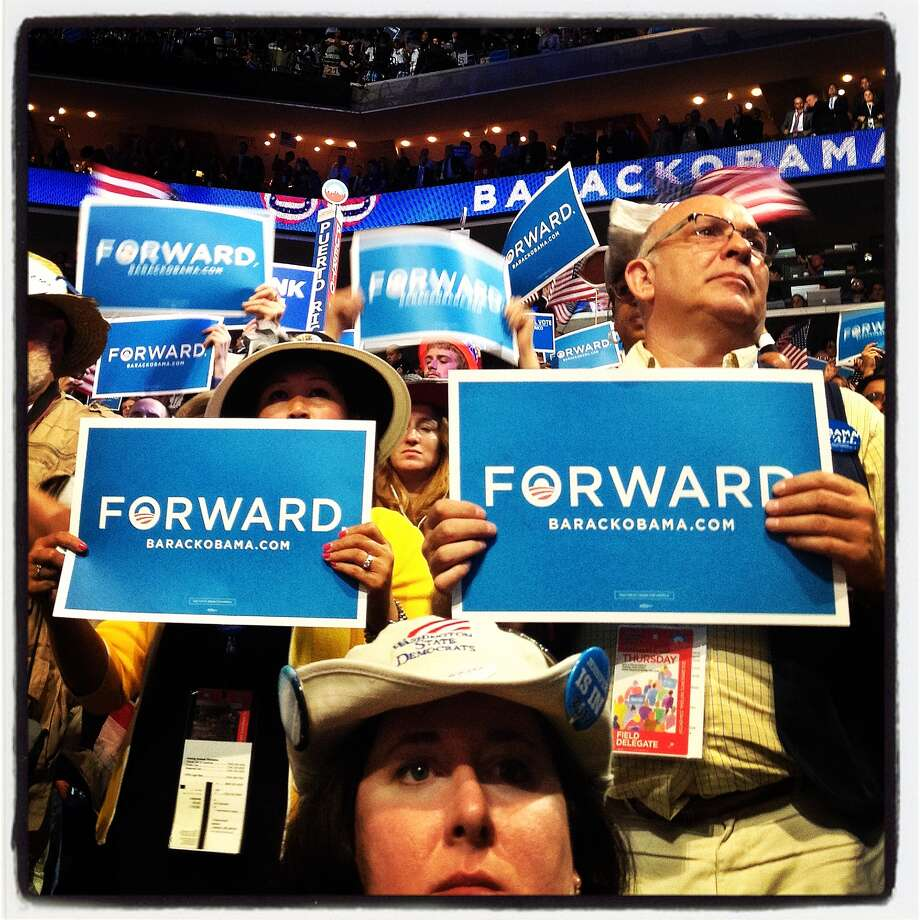 People hold signs as U.S. President Barack Obama speaks during day three of the Democratic National Convention at Time Warner Cable Arena on September 6, 2012 in Charlotte, North Carolina. Clinton nominated U.S. President Barack Obama as the Democratic presidential candidate. Photo: Justin Sullivan, Getty Images / 2012 Getty Images