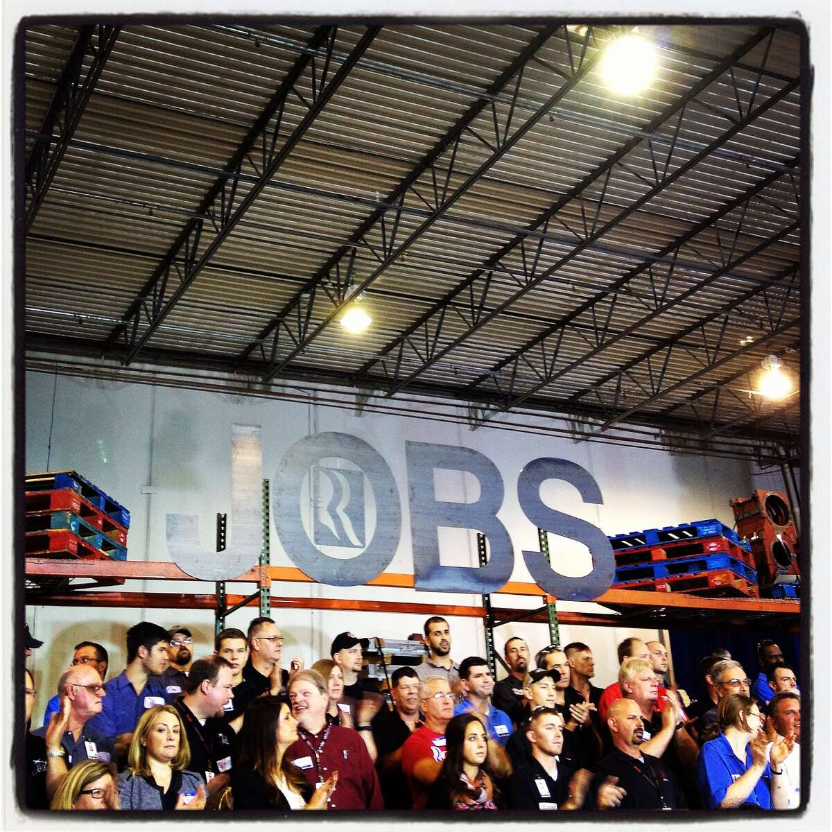 People listen to Republican presidential candidate, former Massachusetts Gov. Mitt Romney speak during a campaign rally on October 25, 2012 in Cincinnati, Ohio. Mitt Romney is campaigning in Ohio with less than two weeks to go before the election.