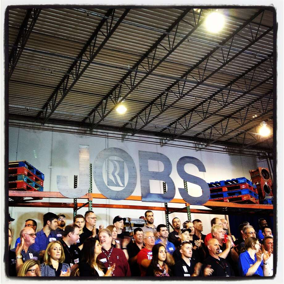 People listen to Republican presidential candidate, former Massachusetts Gov. Mitt Romney speak during a campaign rally on October 25, 2012 in Cincinnati, Ohio. Mitt Romney is campaigning in Ohio with less than two weeks to go before the election. Photo: Justin Sullivan, Getty Images / 2012 Getty Images