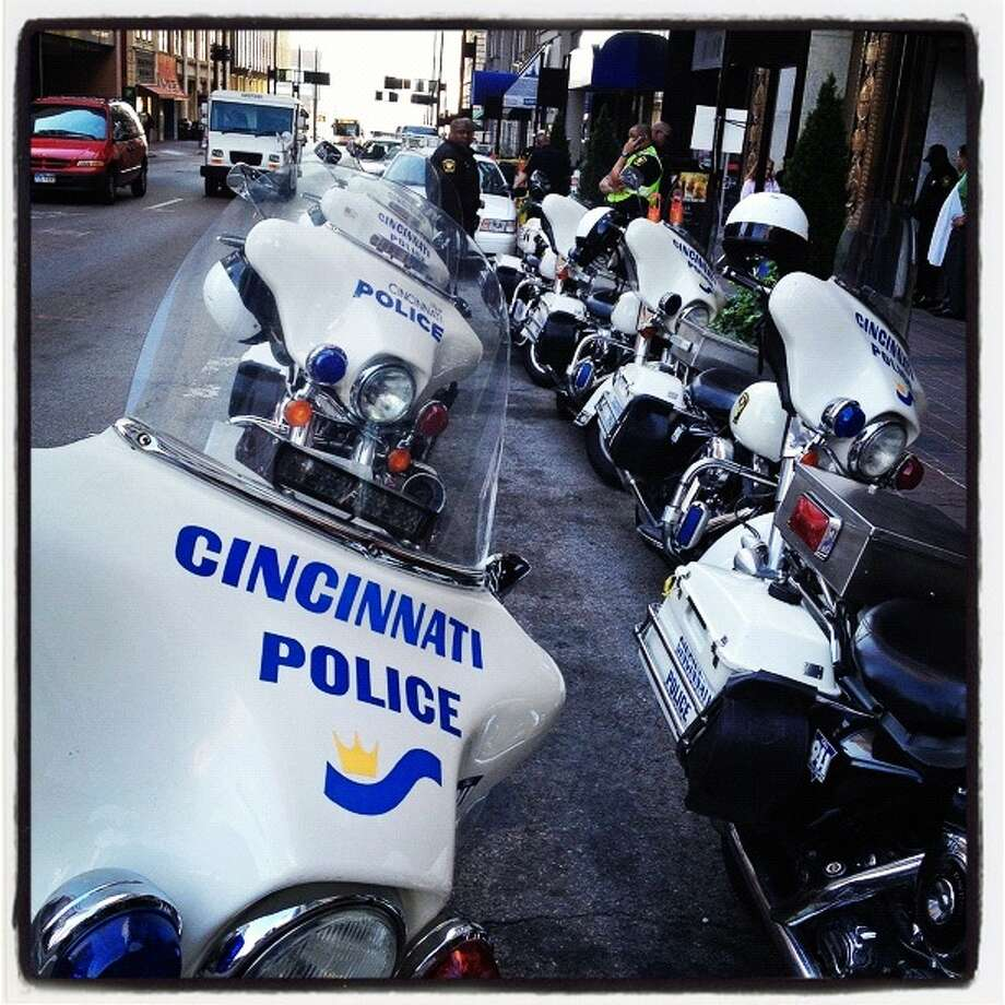 Police motorcycles line up for to Republican presidential candidate, former Massachusetts Gov. Mitt Romney on October 25, 2012 in Cincinnati, Ohio. Mitt Romney is campaigning in Ohio with less than two weeks to go before the election. Photo: Justin Sullivan, Getty Images / 2012 Getty Images