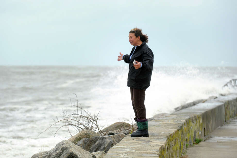 Tomiko Knapp watches storm waters from sea wall along Beach Drive, in the Lordship section of Stratford, Conn. Oct. 29th, 2012. Photo: Ned Gerard