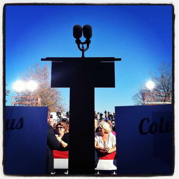 A podium stands empty before a campagn speech by Republican presidential candidate, former Massachus