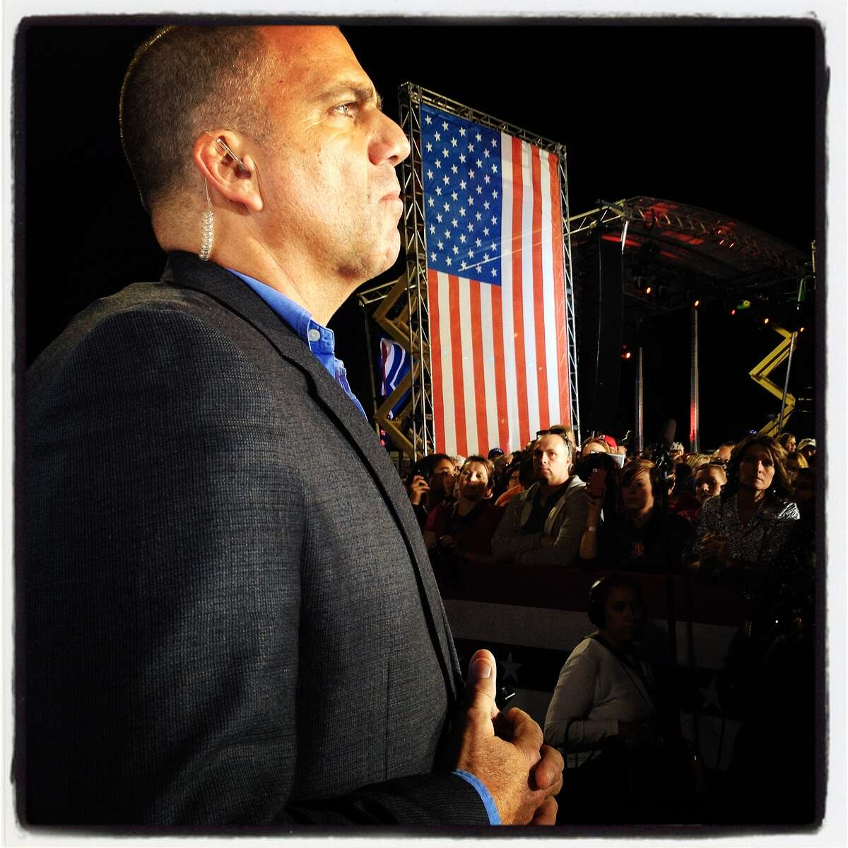 A Secret Service agent stands guard during a campaign speech by Republican presidential candidate, former Massachusetts Gov. Mitt Romney at Defiance High School October 25, 2012 in Defiance, Ohio. Mitt Romney is campaigning in Ohio with less than two weeks to go before the election.