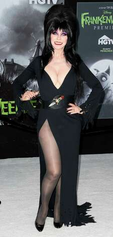 "Elvira, aka Cassandra Peterson, attends the premiere of Disney's ""Frankenweenie"" in Los Angeles. Photo: Frederick M. Brown, Getty Images / 2012 Getty Images"