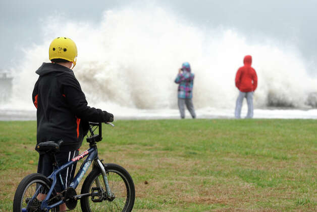 Daniel Collier, 9, watches waves break over the sea wall along Beach Drive, in the Lordship section of Stratford, Conn. Oct. 29th, 2012. Photo: Ned Gerard