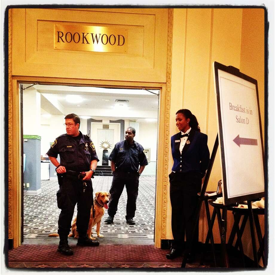 Cincinnati police prepare a security sweep for the traveling press at a campaign event for a Republican presidential candidate, former Massachusetts Gov. Mitt Romney on October 25, 2012 in Cincinnati, Ohio. Mitt Romney is campaigning in Ohio with less than two weeks to go before the election. Photo: Justin Sullivan, Getty Images / 2012 Getty Images