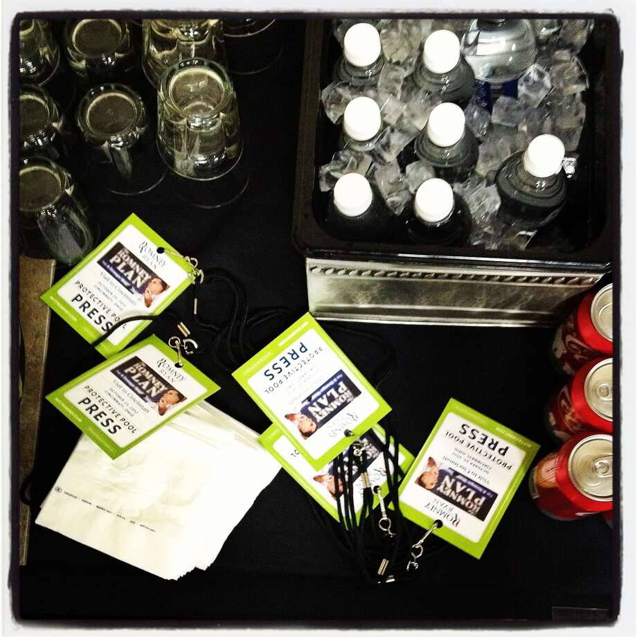 Credential and beverages for a Republican presidential candidate, former Massachusetts Gov. Mitt Romney event sit on a table on October 25, 2012 in Cincinnati, Ohio. Mitt Romney is campaigning in Ohio with less than two weeks to go before the election. Photo: Justin Sullivan, Getty Images / 2012 Getty Images