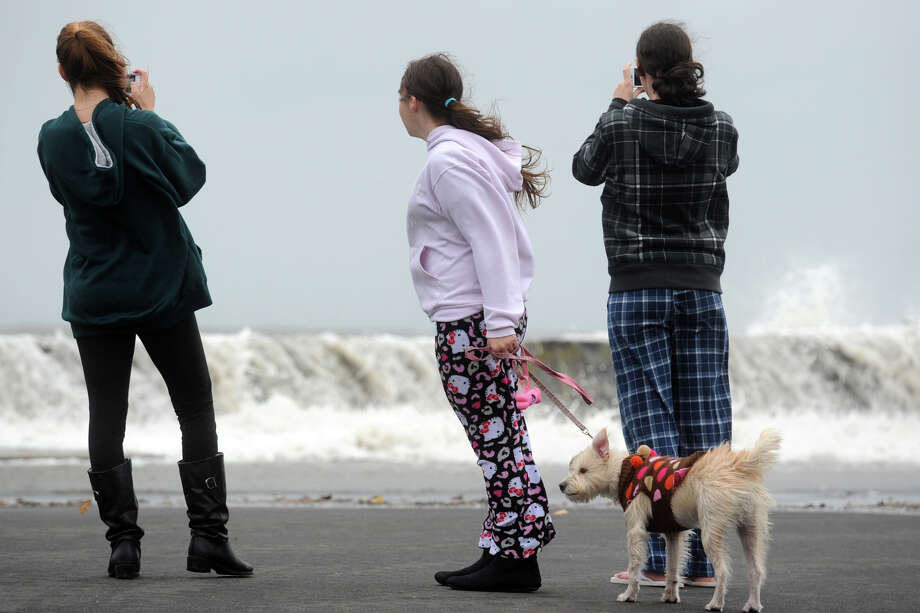 Kids watch as waves break over the sea wall along Beach Drive, in the Lordship section of Stratford, Conn. Oct. 29th, 2012. Photo: Ned Gerard