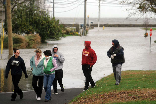 Neighbors gather to watch storm waters flood the Lordship section of Stratford, Conn. Oct. 29th, 2012. Photo: Ned Gerard