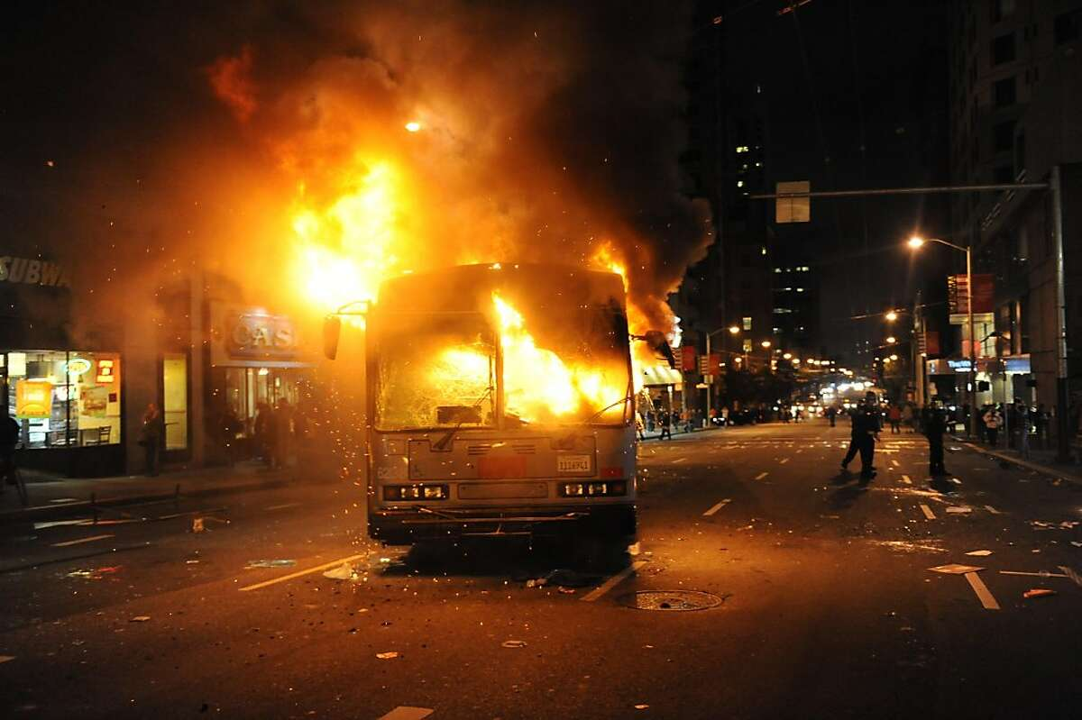 A bus is set on fire on 3rd Street in San Francisco after the Giants won the World Series on October 28, 2012.