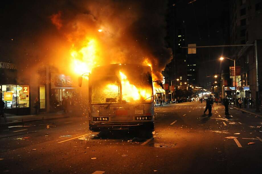 Who's to pay when celebrations get unruly, like the bus set afire after the Giants' World Series win? Photo: Susana Bates, Special To The Chronicle
