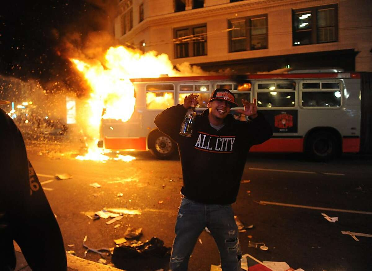 A bus is set on fire in San Francisco after the Giants won the World Series on October 28, 2012.