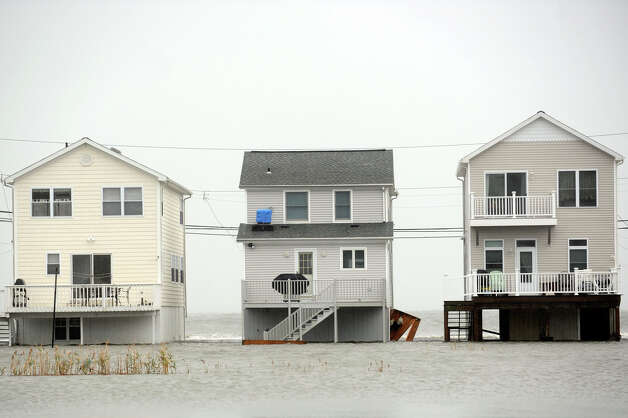 Storm water floods around beach homes in the Lordship section of Stratford, Conn. Oct. 29th, 2012. Photo: Ned Gerard