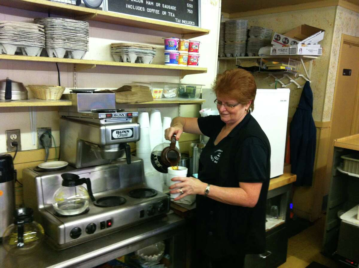 Johanne Forth, owner of Joe's Diner in Stratford, pours a cup of coffee to go Monday as Hurricane Sandy threatens to hit the Northeast.
