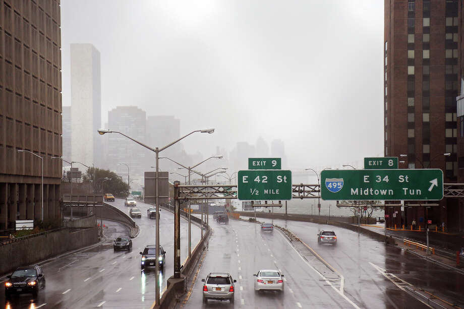Motorists drive on the FDR Drive along the banks of the East River ahead of Hurricane Sandy on eastside of Manhattan on October 29, 2012 in New York City. Sandy, which has already claimed over 50 lives in the Caribbean is predicted to bring heavy winds and floodwaters to the mid-Atlantic region. Photo: Michael Heiman, Getty Images / 2012 Getty Images