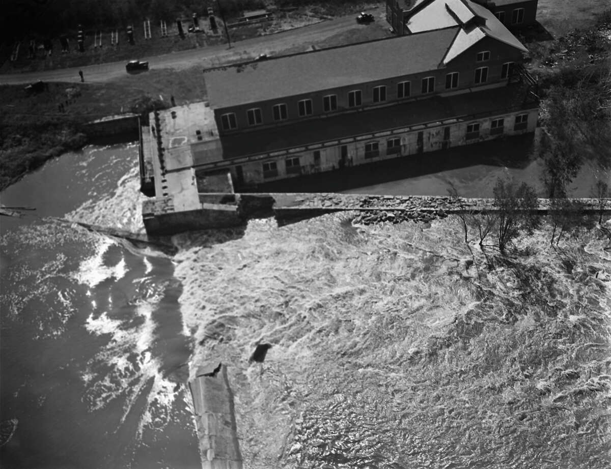 Flood waters were at their crest in the 1938 New England hurricane when this photo was made on Sep. 21, in Providence, R.I. Dockhouses float or stand inundated near the railroad bridge over the Seekonk River. A tog lies wrecked in the bridge's crib work. People and property were swept into the river by winds with gusts up to 186 miles an hour, and carried away. At loast 600 were left dead in New England when the storm passed on after several hours of mad fury. (AP Photo)