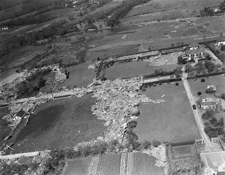 Scattered over the landscape as if some giant wand had spilled a box of matches is this Westhampton, N.Y. summer residence. The hurricane winds which struck on Sep. 21, 1938 in Long Island . The Rowboat, center right absurdly deposited in someone's yard. (AP Photo) Photo: ASSOCIATED PRESS / AP1938