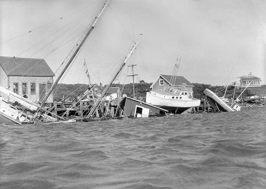 Boats sunk, were driven up on dock and buildings knocked into water in the Menemsha section, Martha's Vineyard, Mass., Aug. 31, 1954, as a howling hurricane accompanied by fiercely driving rain struck New England causing millions of dollars damage. Photo: AP